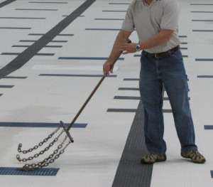 Large tile areas can be sounded with a chain.