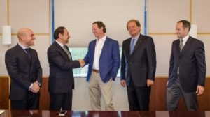 Mr. Luigi Di Geso, President and CEO of MAPEI Americas shaking hands with Mr. Travis Collins, General Manager of GRT