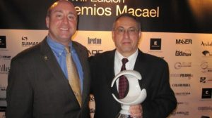 "Tony Malisani (l.) and David Castellucci proudly hold the ""Institution Award"" at the Macael Awards event"