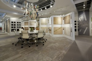 The space tailors the format of other Daltile design studios by reflecting what is hot in Miami right now - whites, neutrals and big, bold shapes.   At the center of the space, a custom chandelier made with tile pieces hangs over a large meeting table.