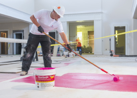 To guard against cracks potentially transmitting up into the tile assembly from the subfloor, CUSTOM's RedGard® Waterproofing and Crack Prevention Membrane was rolled onto horizontal surfaces.