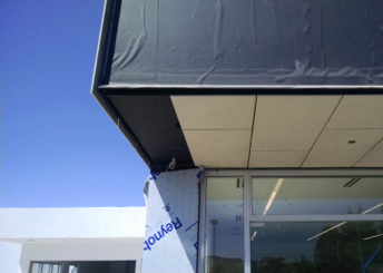 Figures 4 and 5 - Installation of porcelain rainscreen panels in progress, revealing ventilated air cavity and air, moisture and vapor (AMV) barrier installed by others.  Note this project did not require any outboard continuous insulation.