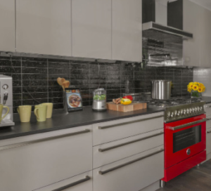 John Colaneri of HGTV's Kitchen Cousin used the Under-Cabinet Lighting System to provide an unobstructed field of on-trend black subway tile in his home kitchen.