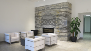 The Daltile Denver showroom features a fireplace vignette with four book-matched slabs.