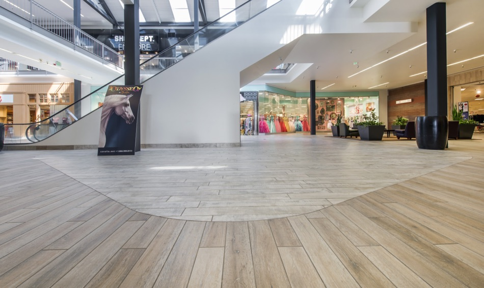 Gensler's design intent was to bring the natural forms into the interior space, adding warmth and a fluid floor pattern. Porcelain tiles are durable for high-traffic commercial use and meet the slip coefficient.