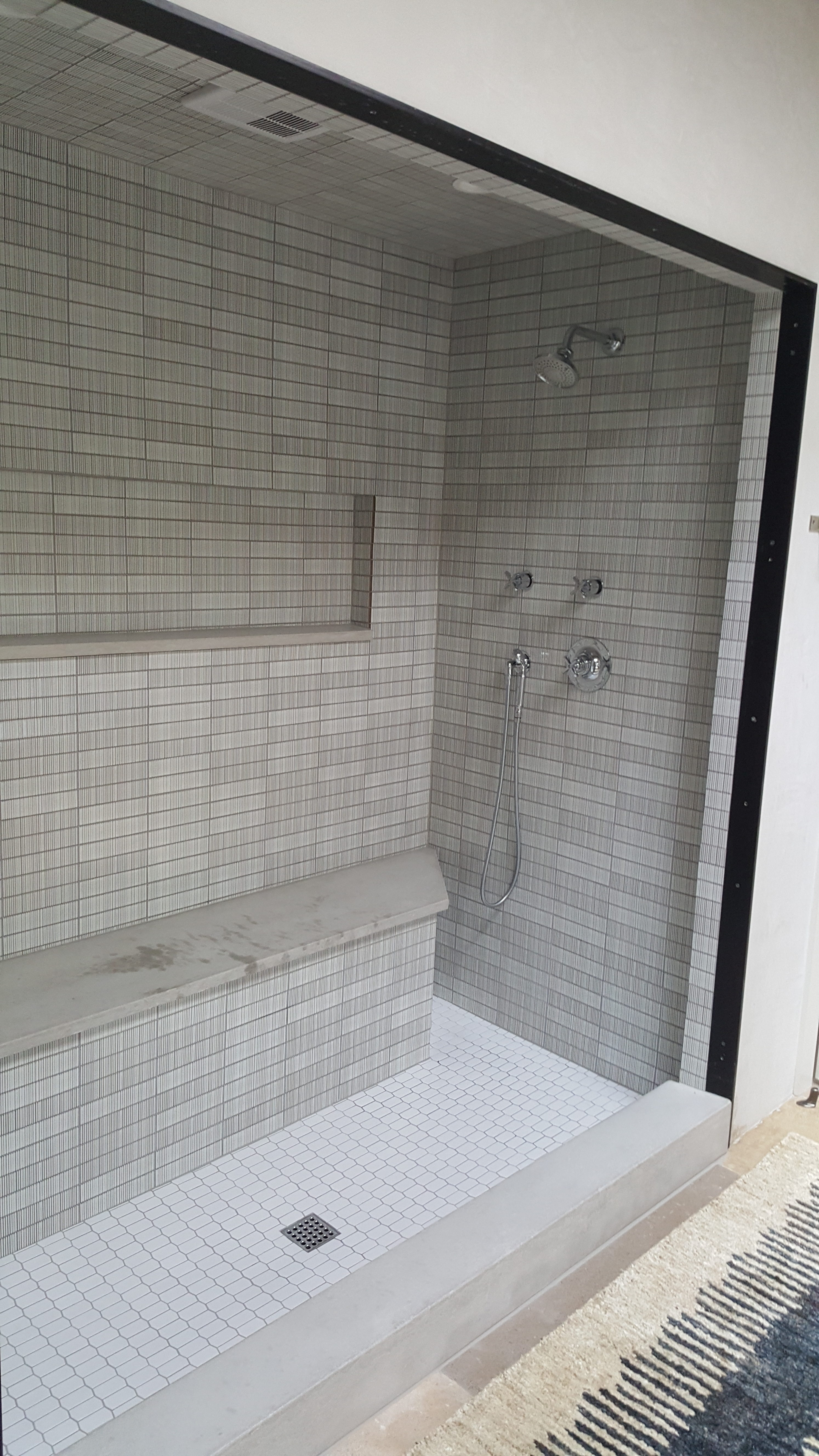 Ntca five star contractors tileletter ceramic tile shower walls in soldier course over cement board with waterproofing membrane bench was built from cinderblock with limestone accents in niche dailygadgetfo Gallery